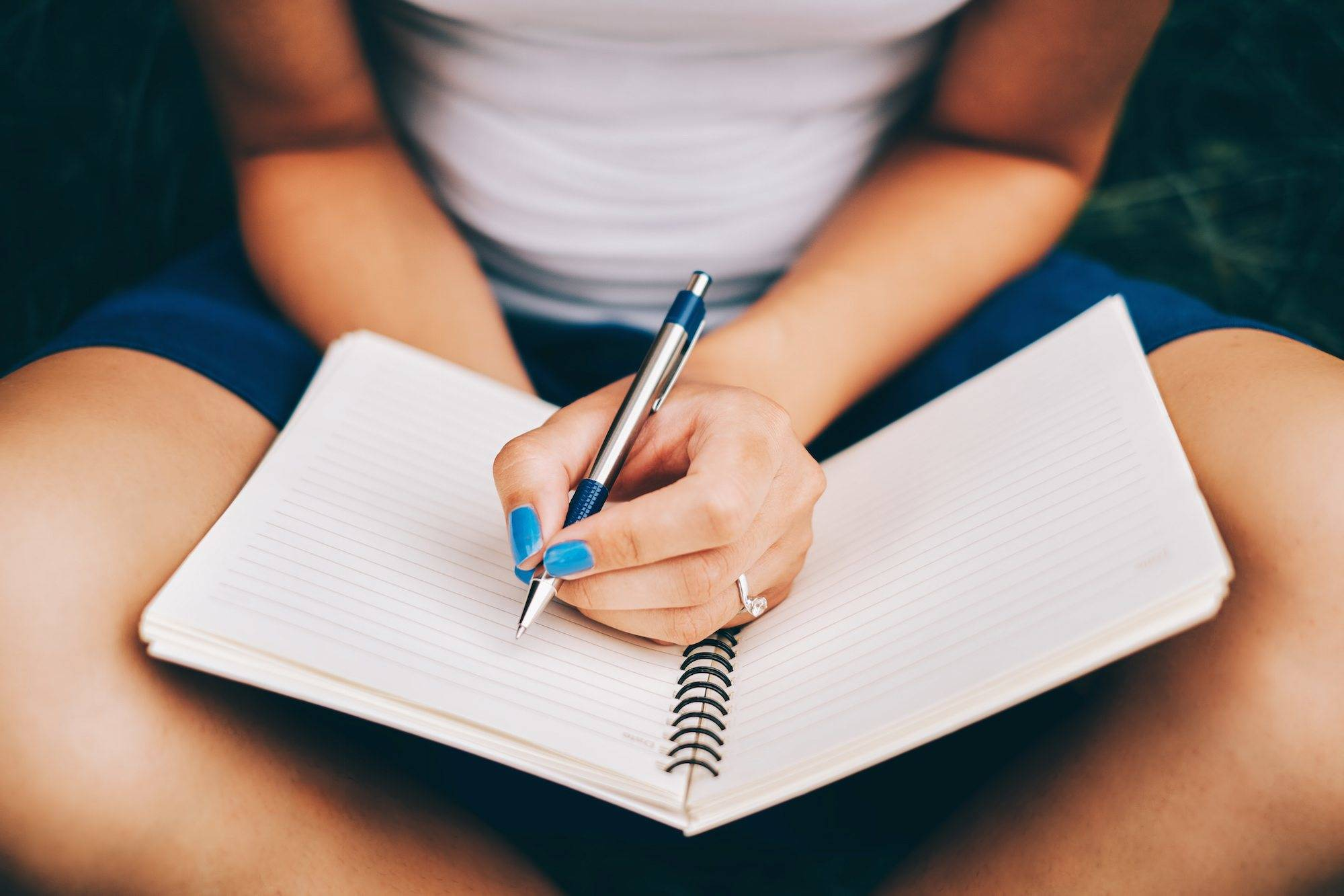 woman-writing-in-journal