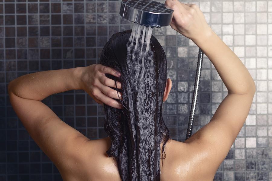Young Woman Washing Her Long Hair